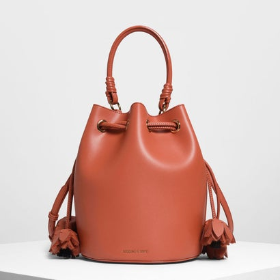 フローラルタッセルドローストリングバックルバッグ / FLORAL TASSEL DRAWSTRING BUCKET BAG (Orange